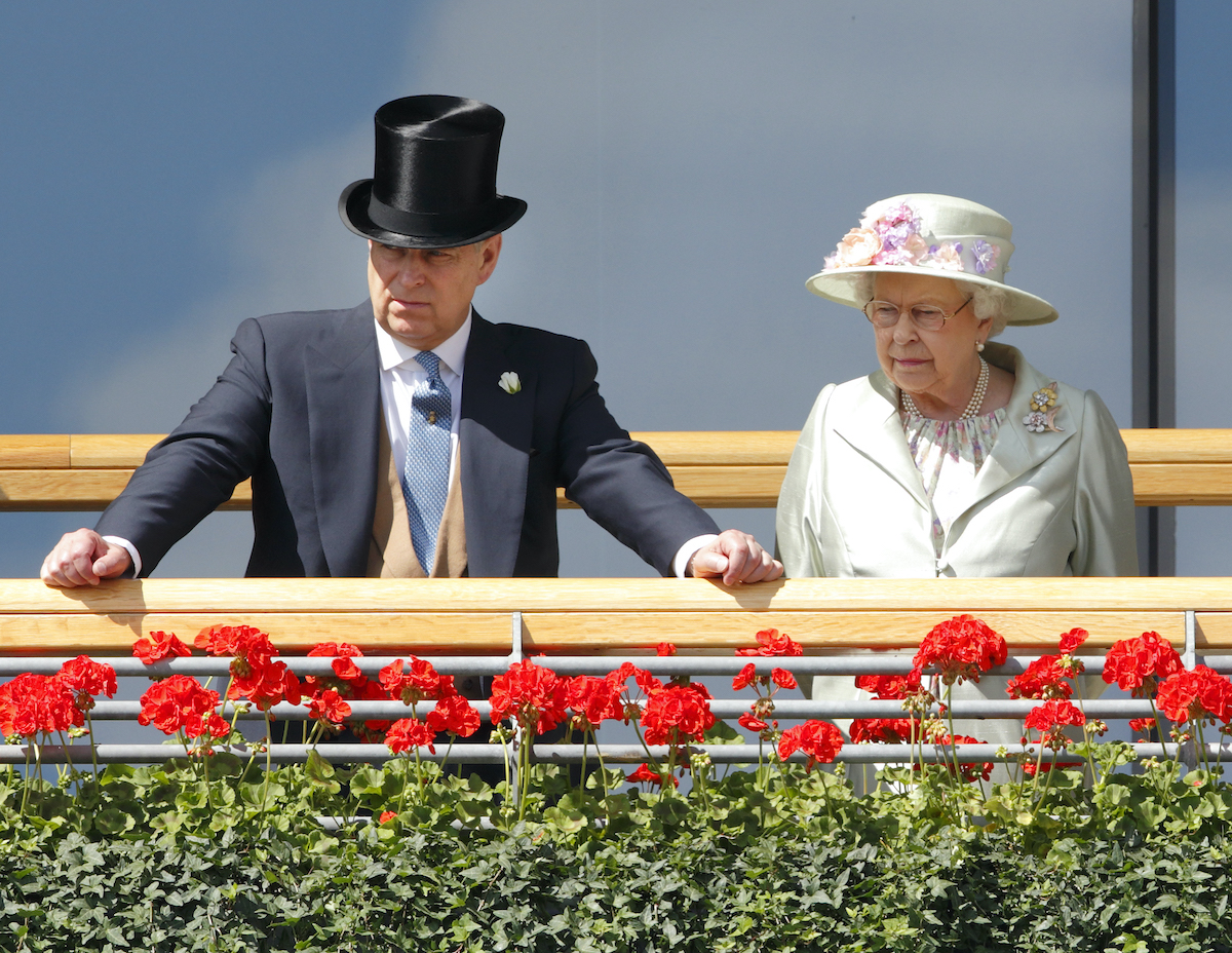 Queen Elizabeth and Prince Andrew stand on the balcony of the Royal Ascot