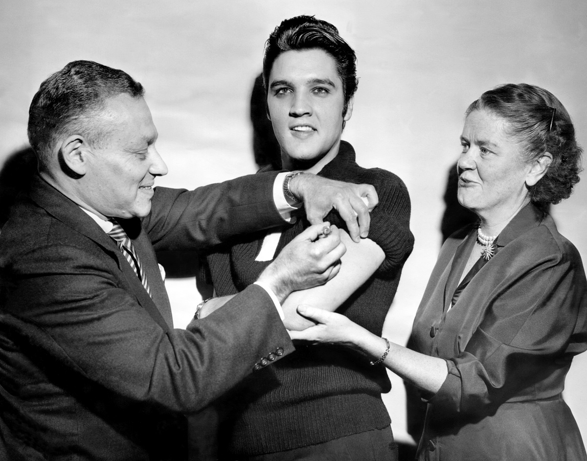 Elvis Presley receiving a polio vaccination from Leona Baumgartner and Harold Fuerst at CBS Studio 50 in New York City before 'The Ed Sullivan Show' in 1956