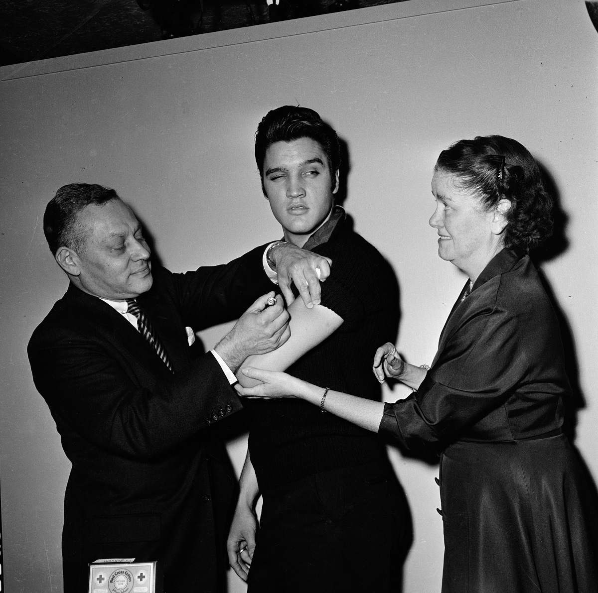 Elvis Presley getting the polio vaccine from two clinicians in 1956 before his performance on 'The Ed Sullivan Show'