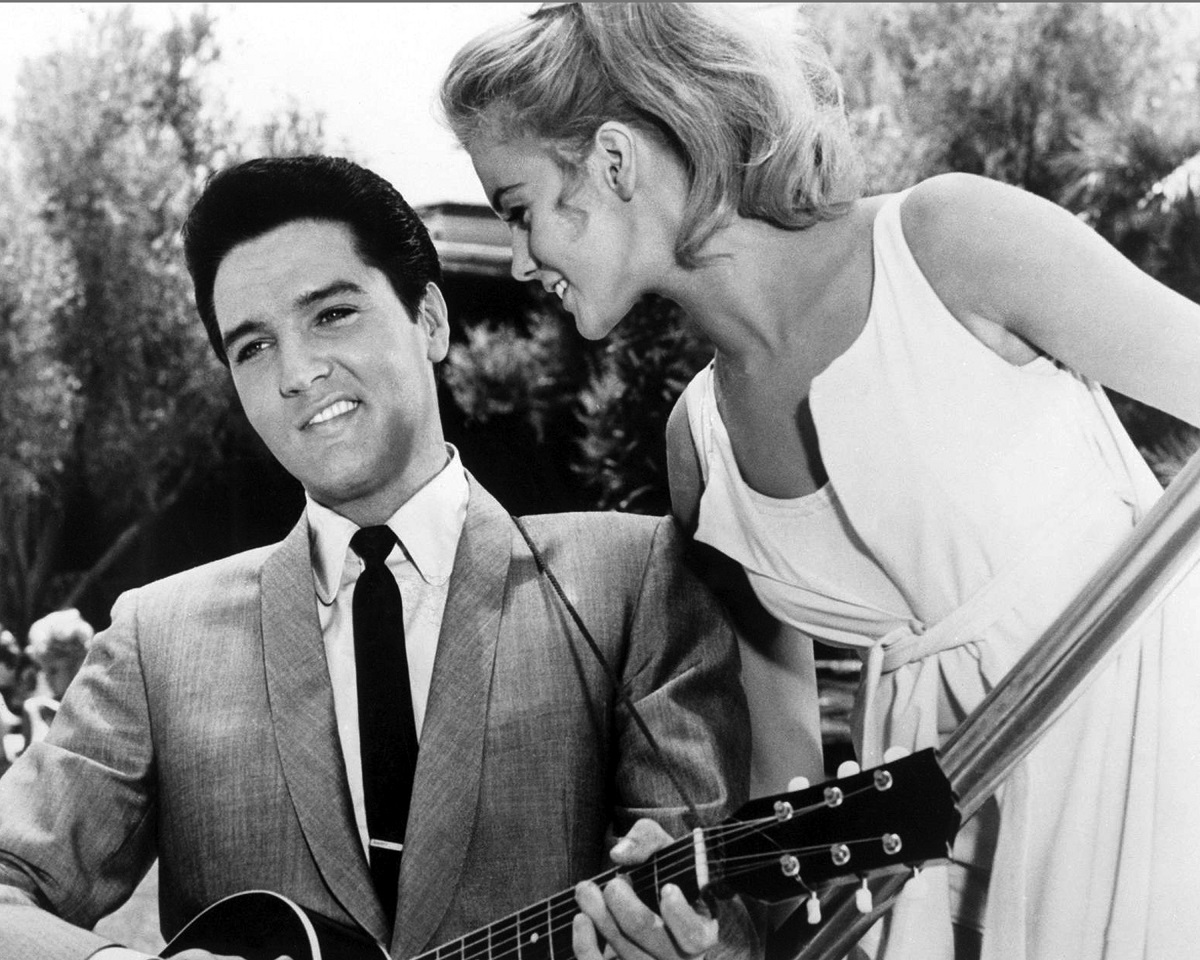 Elvis Presley singing to a smiling Ann-Margret in a scene from 'Viva Las Vegas' (1964). The photo is a black and white still from the film.