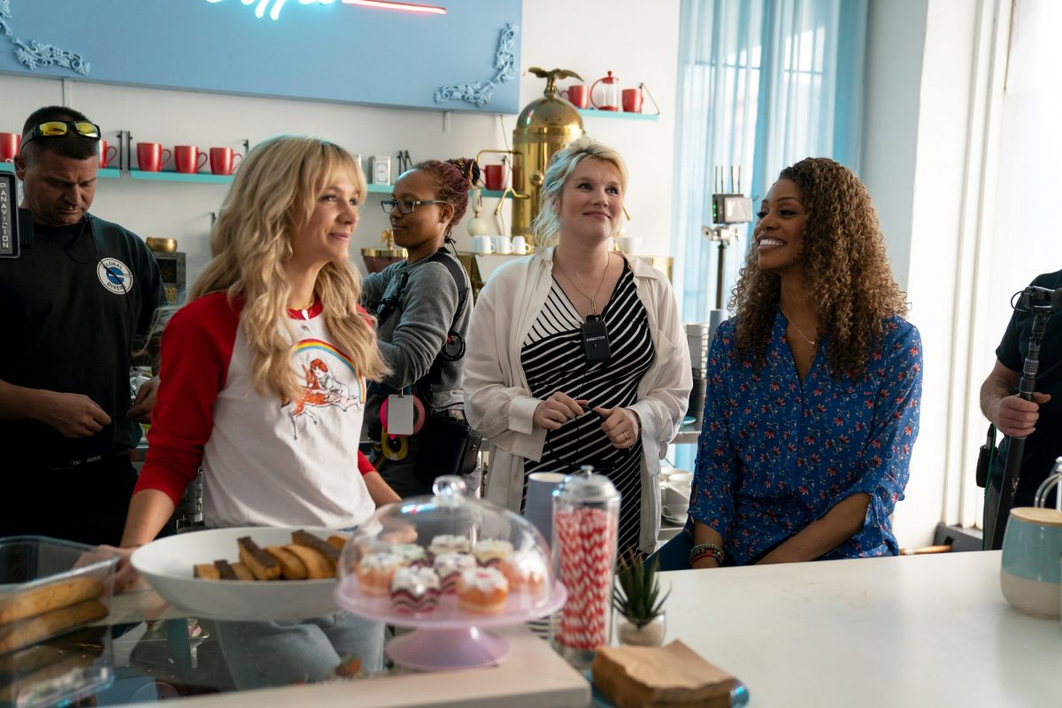 Emerald Fennell directing Carey Mulligan and Laverne Cox in the coffee shop