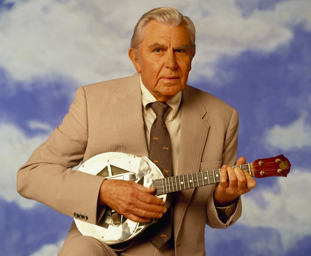 Andy Griffith as 'Matlock' holds a small guitar in 1992