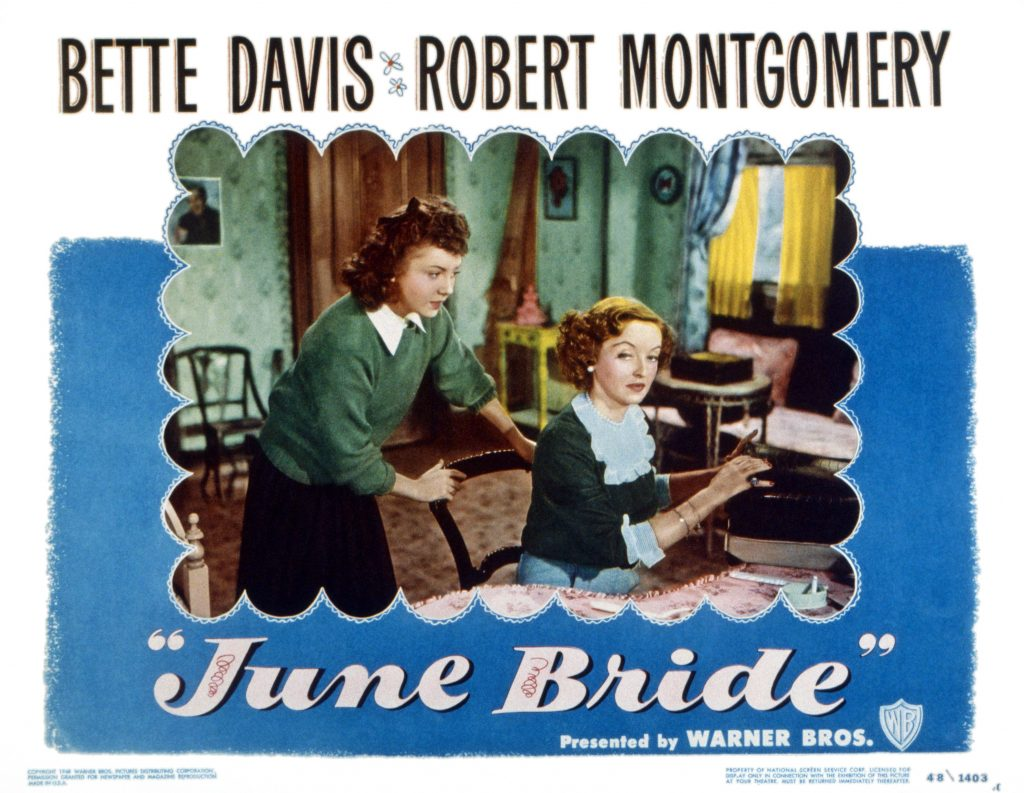 A lobbycard from the 1948 film 'June Bride' shows, left to right, Betty Lynn and (seated) Bette Davis