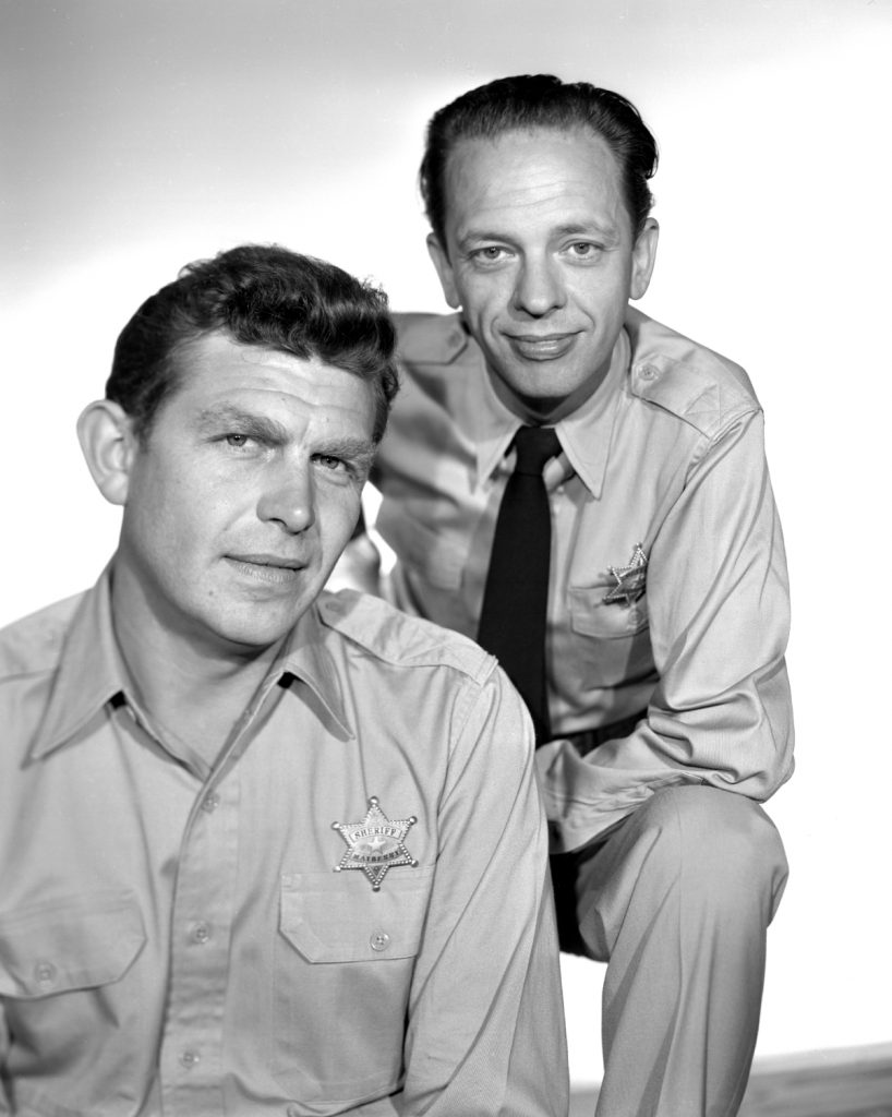Andy Griffith and Don Knotts pose for a photo as Andy Taylor and Barney Fife in 'The Andy Griffith Show'