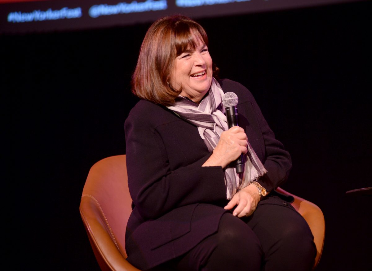 'Barefoot Contessa' star Ina Garten addresses an audience while sitting in an orange seat with a microphone in hand