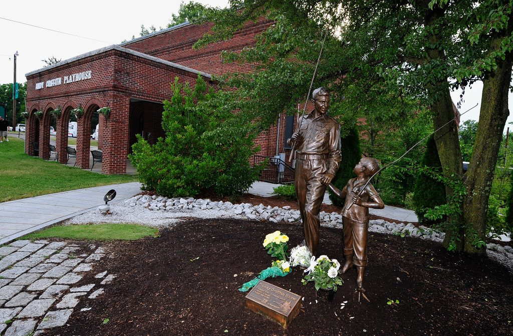 Statue of 'The Andy Griffith Show' characters Andy and Opie Taylor holding hands and fishing rods