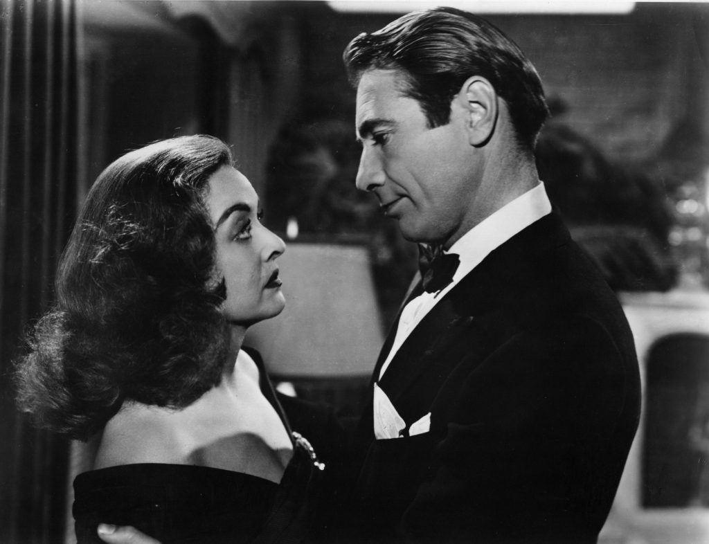 Bette Davis and former husband Gary Merrill embrace in a scene from 'All About Eve', 1950