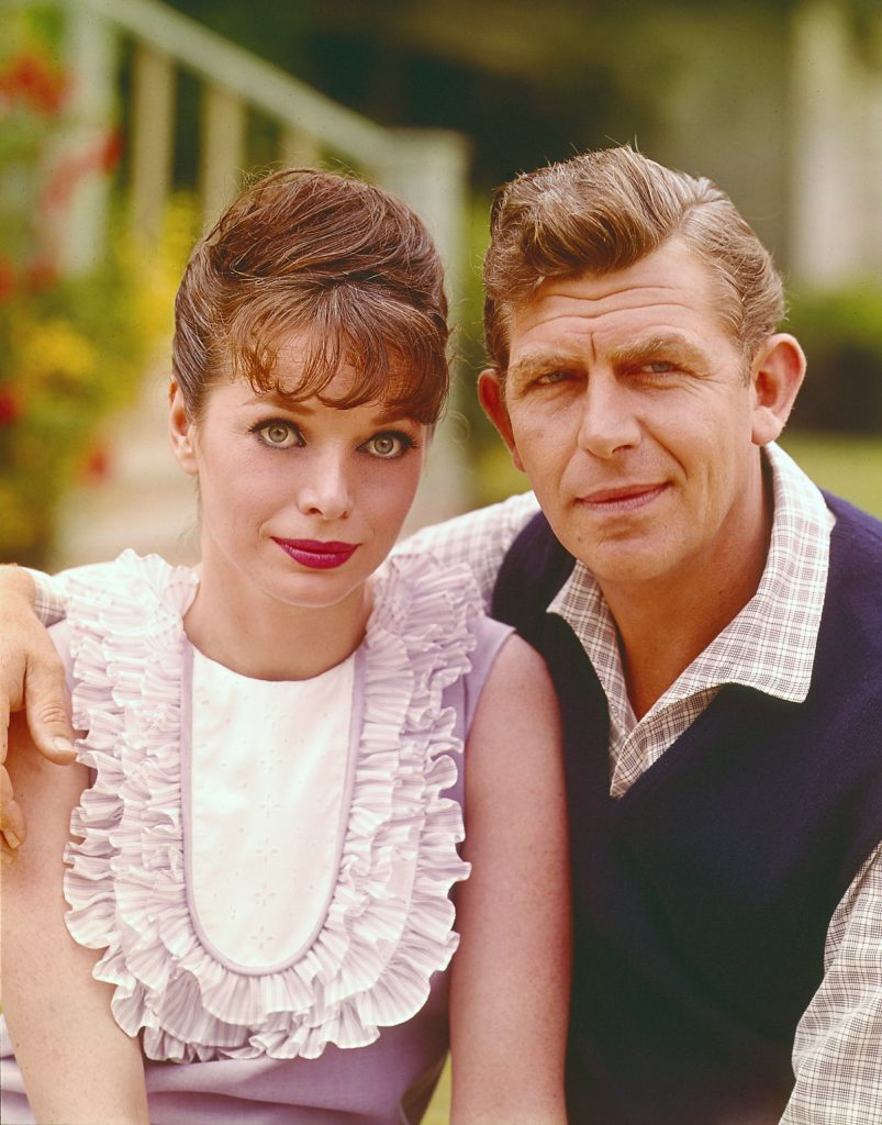(L to R): Aneta Corsaut and Andy Griffith pose for a photo together, his arm draped around her shoulder