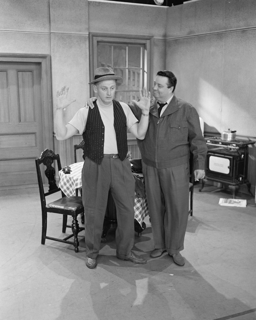 Jackie Gleason and Art Carney in a scene from 'The Honeymooners'