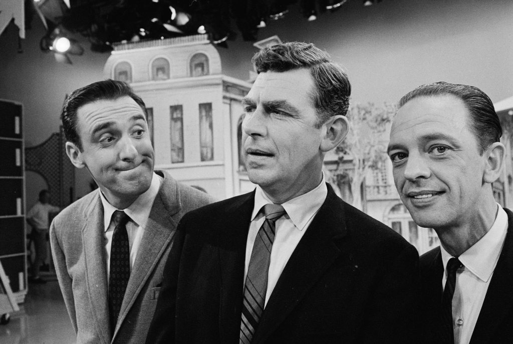 Actors Jim Nabors, Andy Griffith, and Don Knotts of 'The Andy Griffith Show' pose for a photo, 1965