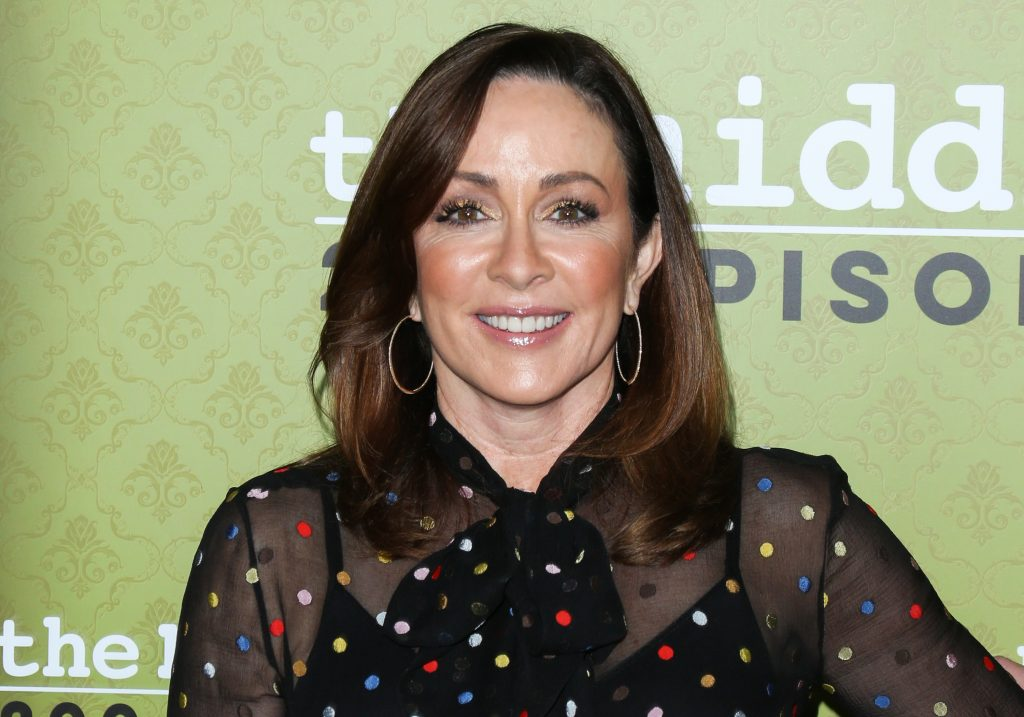 Former 'Everybody Loves Raymond' star Patricia Heaton wears a black polka-dot blouse and hoop earrings as smiles for the camera in 2017