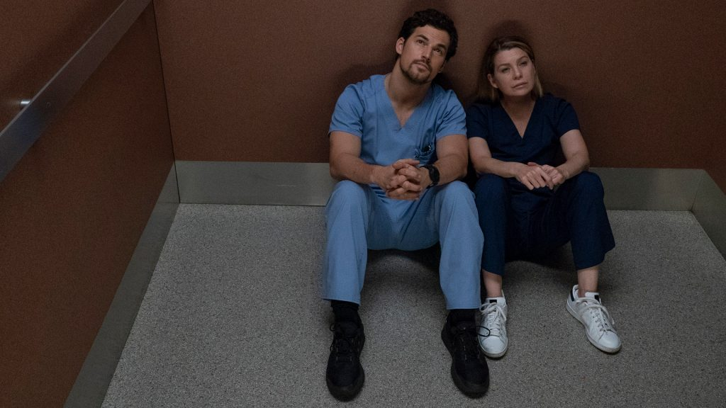 Giacomo Gianniotti as Andrew DeLuca and Ellen Pompeo as Meredith Grey sitting in the elevator in 'Grey's Anatomy' Season 15