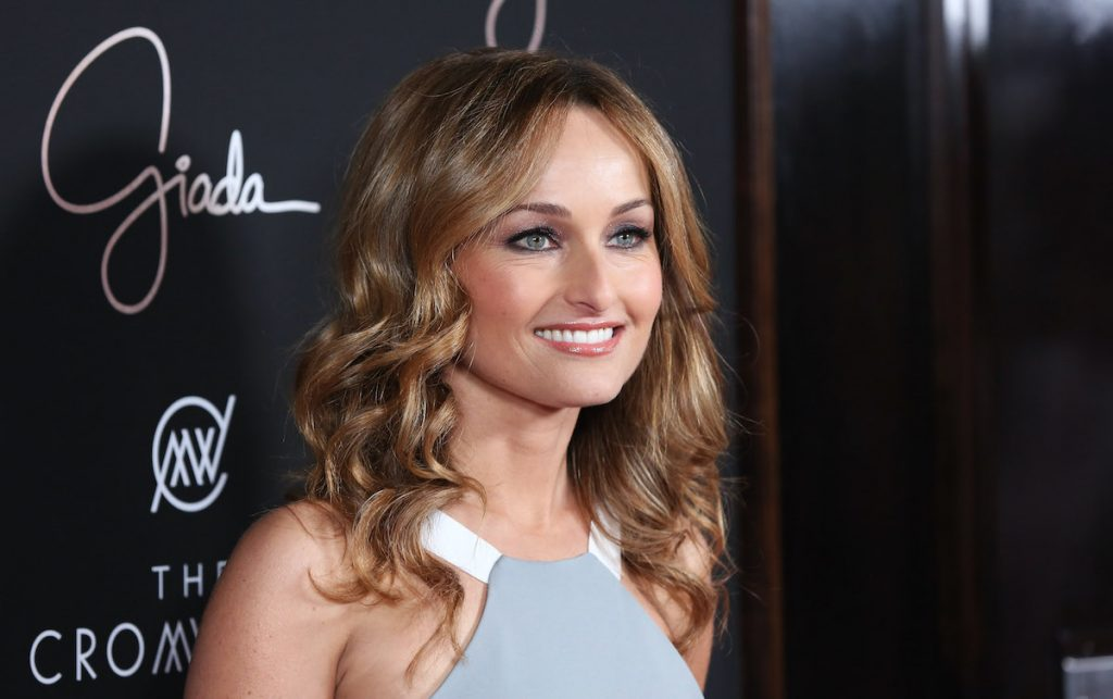 Celebrity chef Giada De Laurentiis poses for a photo in a gray sleeveless top, 2014