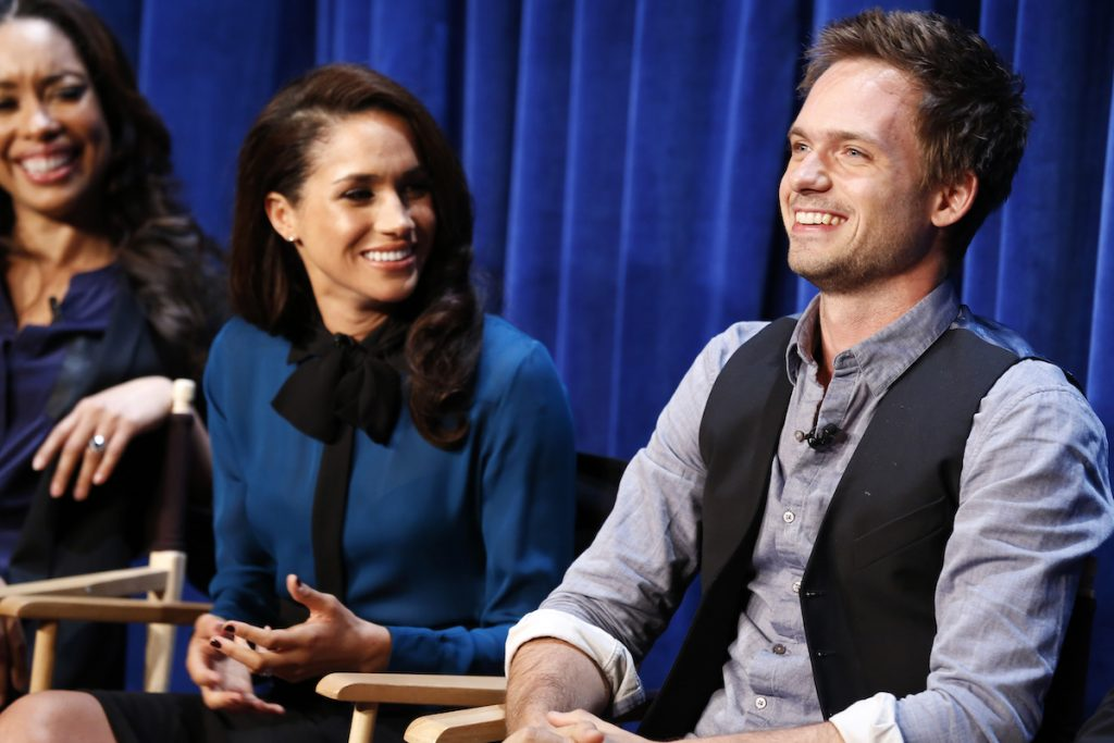 Gina Torres, Meghan Markle, Patrick J. Adams smile at a panel and screening for Suits