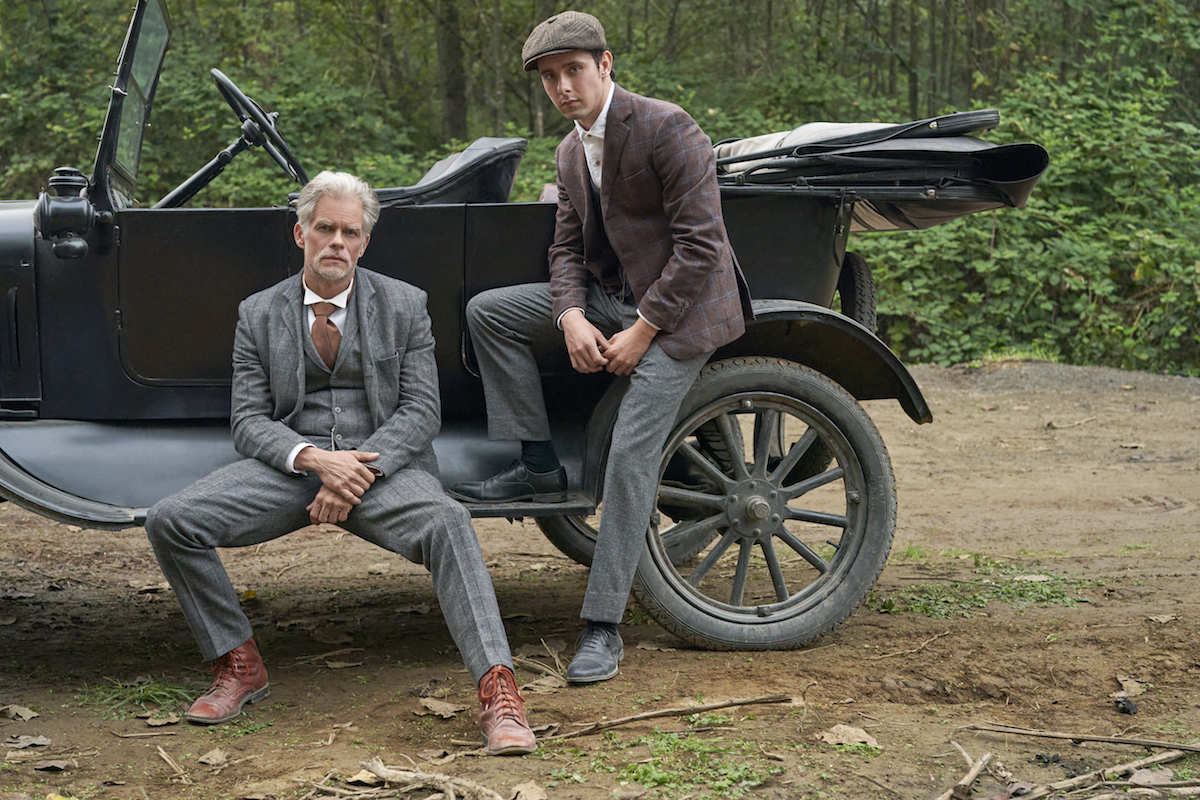 Gowen and Chrisopher sitting on a car's running board in When Calls the Heart