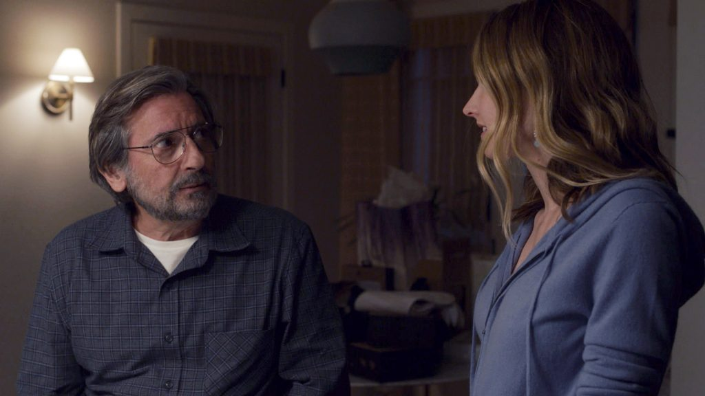 Griffin Dunne as Nicky and Caitlin Thompson as Madison talking in front of Justin Hartley as Kevin in 'This Is Us' Season 5 Episode 11