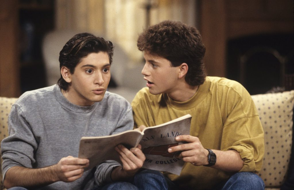 (L-R) Andrew Koenig and Kirk Cameron on 'Growing Pains' sitting on a couch
