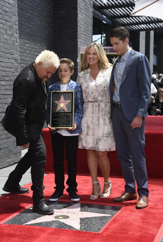 Guy Fieri, his wife, Lori, and two kids, Hunter and Ryder, attend his Hollywood Walk of Fame ceremony in 2019.