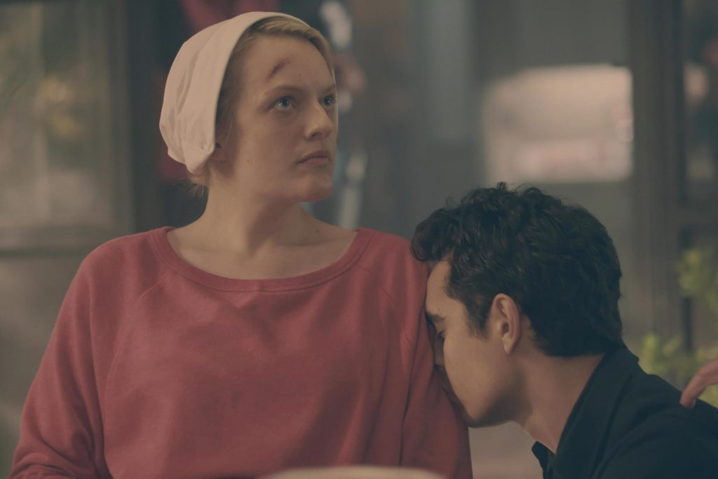 'The Handmaid's Tale' Season 4 star Elisabeth Moss as June Osborne allowing actor Max Minghella as Nick to rest his head on her shoulder