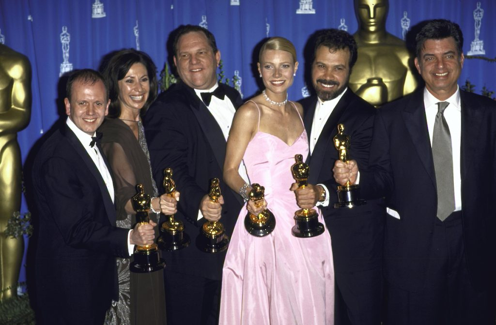 Miramax Films executive Harvey Weinstein and actress Gwyneth Paltrow holds their trophies with Shakespeare in Love producers and Oscar award winners