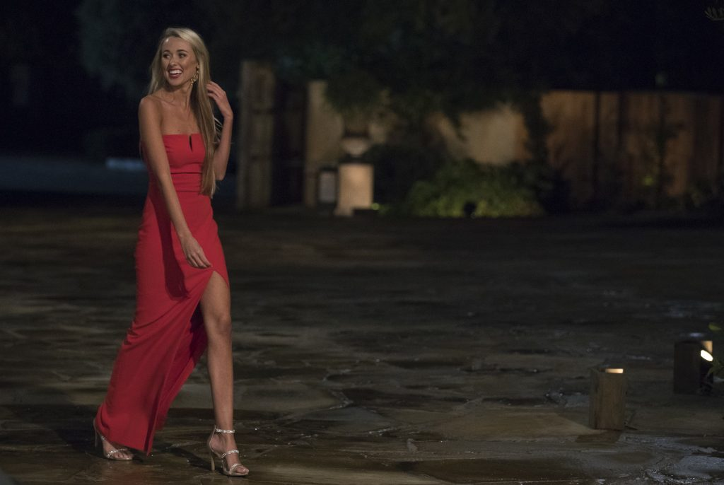Heather Martin, one of the 'Bachelor' contestants on Colton Underwood's season, walking in a red dress