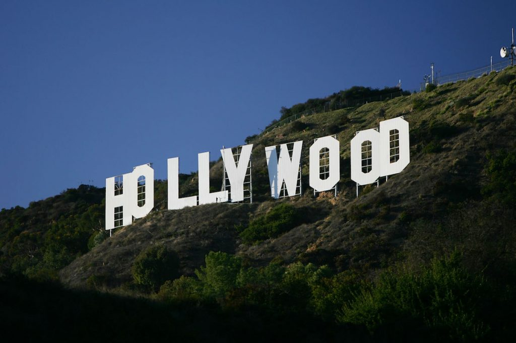 LA's white Hollywood sign tucked away against the hills.