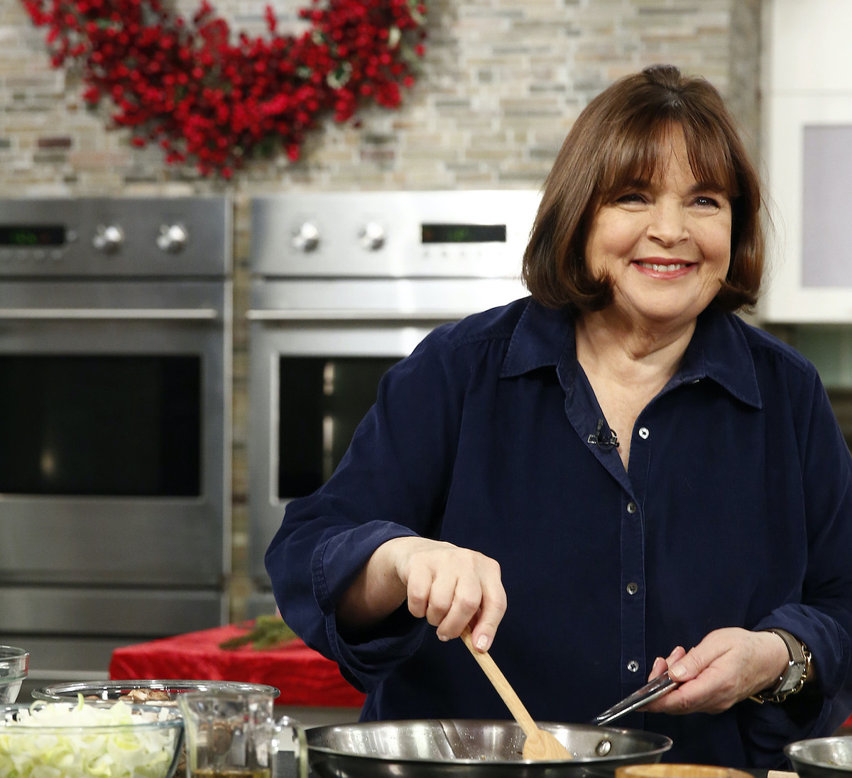 Ina Garten smiles as she stirs food with a wooden spoon on the Today show