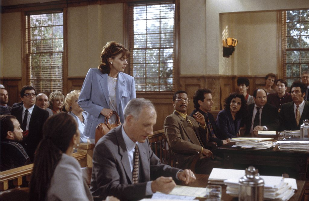 Marla Penny, along side D.A. Hoyt, Jackie Chiles, Jerry, Elaine Benes, George Costanza and Cosmo Kramer in a courthouse scene from the final episode of 'Seinfeld' in 1998