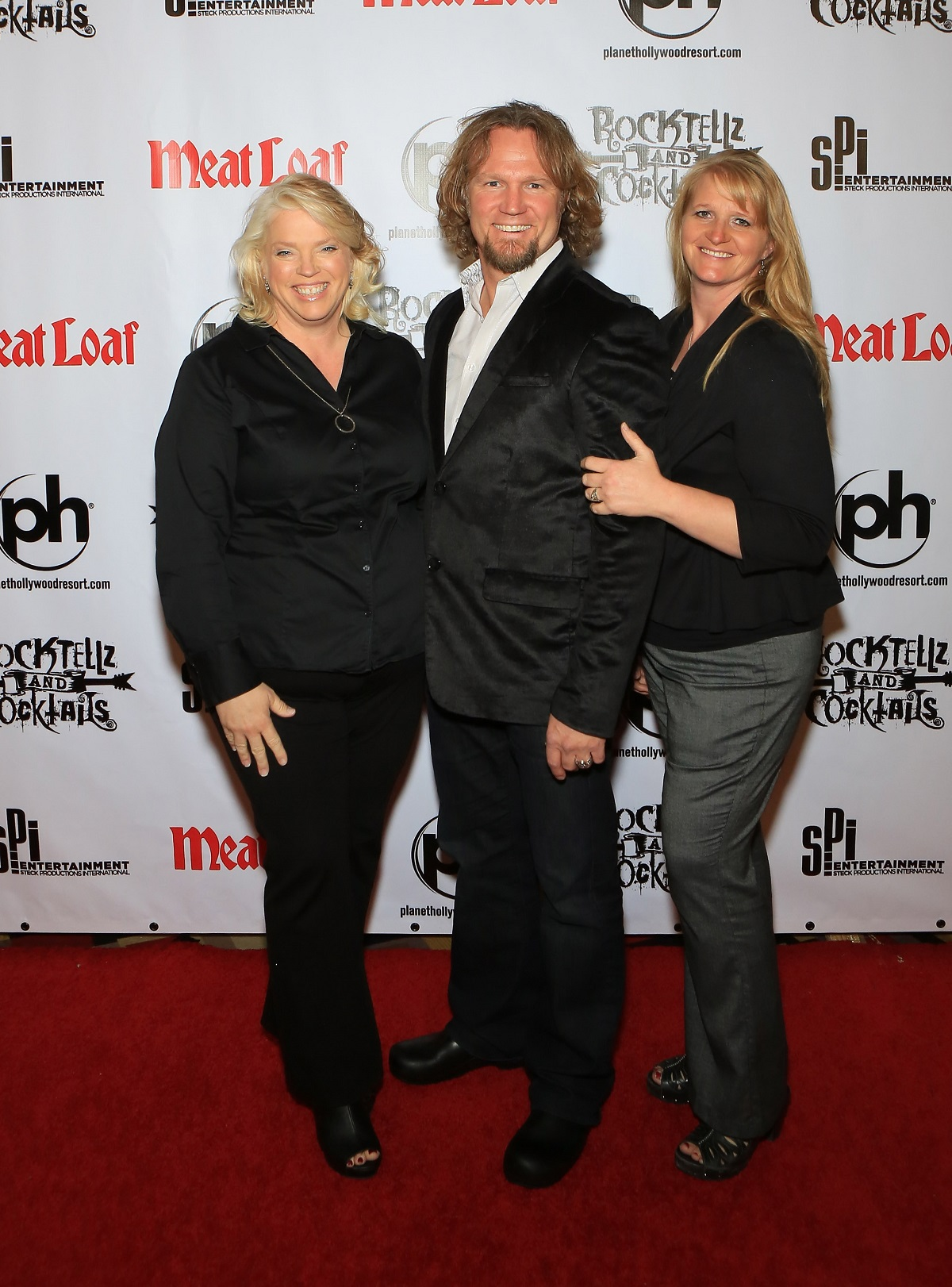 "Janelle Brown, Kody Brown and Christine Brown from ""Sister Wives"" arrive at the show ""RockTellz & CockTails presents Meat Loaf"" at Planet Hollywood Resort & Casino on October 3, 2013 in Las Vegas, Nevada."