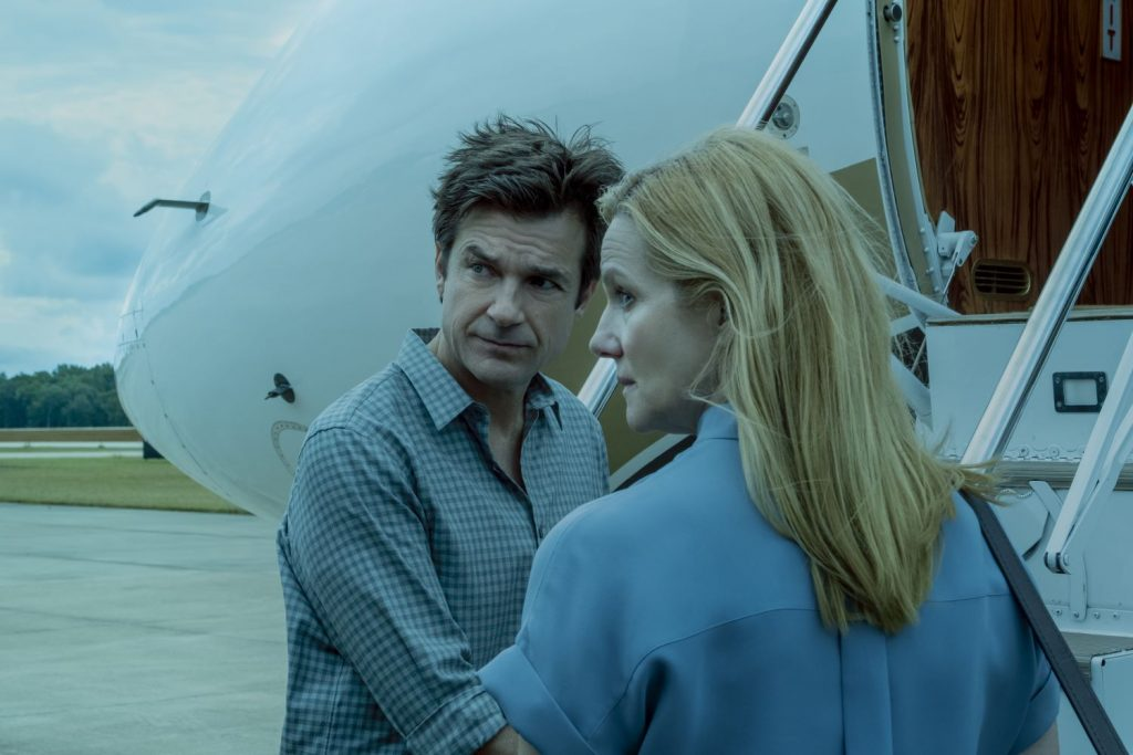 Jason Bateman and Laura Linney preparing to board a plane in a scene from the Netflix show 'Ozark'