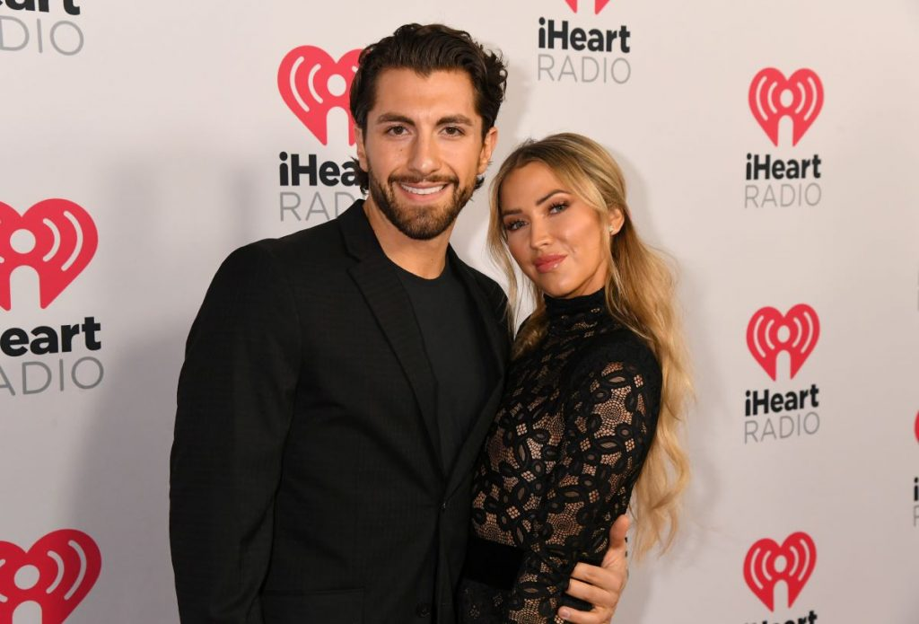 Jason Tartick and Kaitlyn Bristowe pose together at the 2020 iHeartRadio Podcast Awards