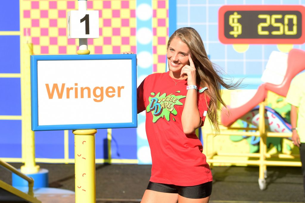Jenna Compono from MTV's 'The Challenge' outside with her finger to her head as she's playing Double Dare games