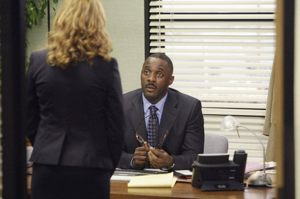 Jenna Fischer as Pam Beesly and Idris Elba as Charles Miner filming an episode of The Office
