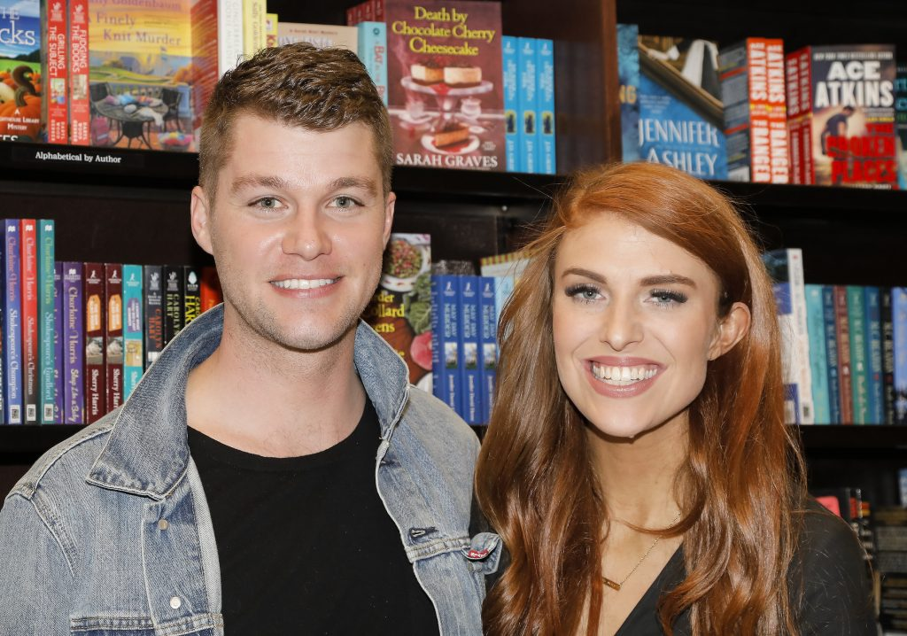 Jeremy Roloff, a member of the Roloff family from TLC's 'Little People, Big World,' and his wife, Audrey Roloff, smiling at a book signing
