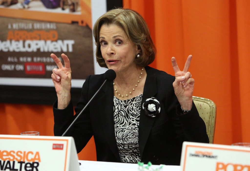Jessica Walter from 'Arrested Development' speaking at a press conference with both hands up making air quotes