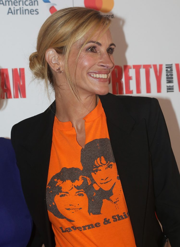 Julia Roberts smiling in T-shirt and blazer at a Pretty Woman-based musical
