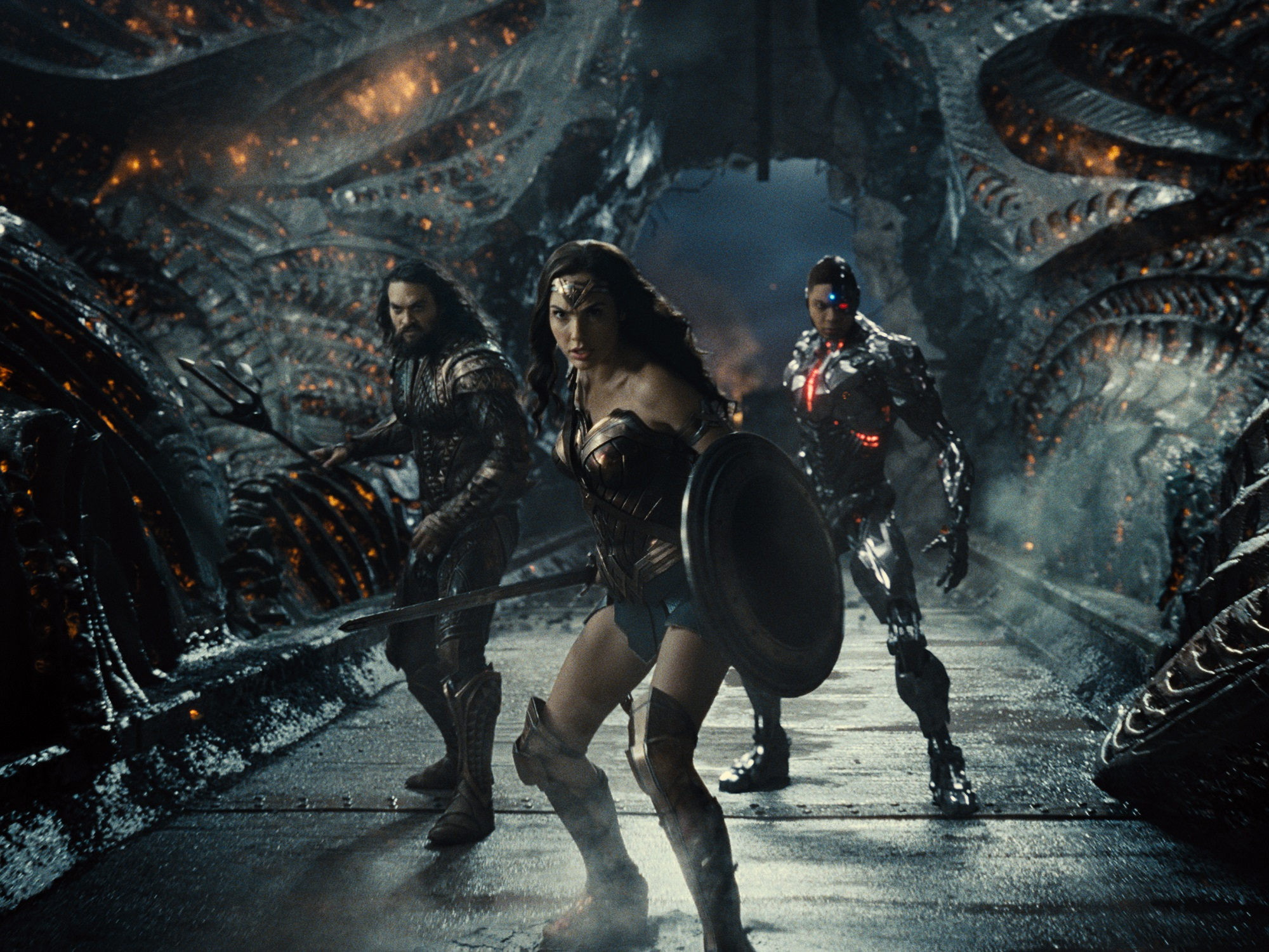 Justice League members Aquaman, Wonder Woman and Cyborg prepare for battle