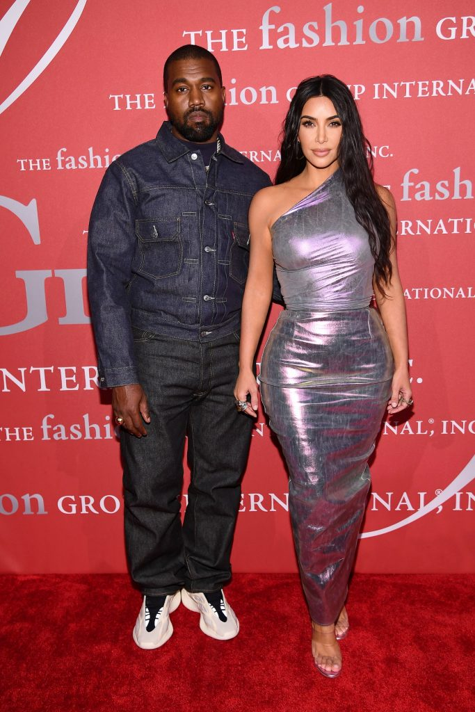 Kanye West and Kim Kardashian stand together on red carpet for photos at the 2019 FGI Night of Stars Gala