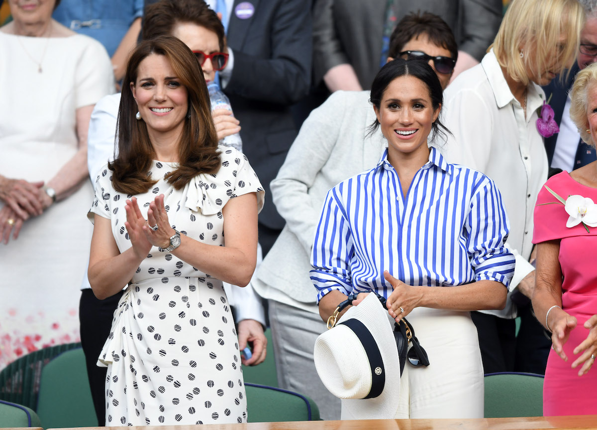 Kate Middleton stands next to Meghan Markle at Wimbledon in 2018