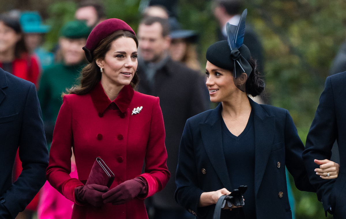 Kate Middleton and Meghan Markle walk together as they attend church on Christmas Day in 2018