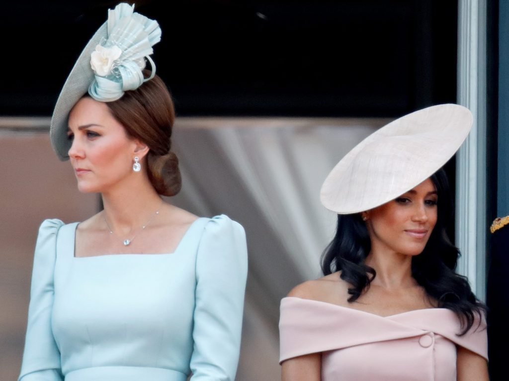 Kate Middleton and Meghan Markle stand nect to each other on the balcony of Buckingham Palace during Trooping The Colour 2018