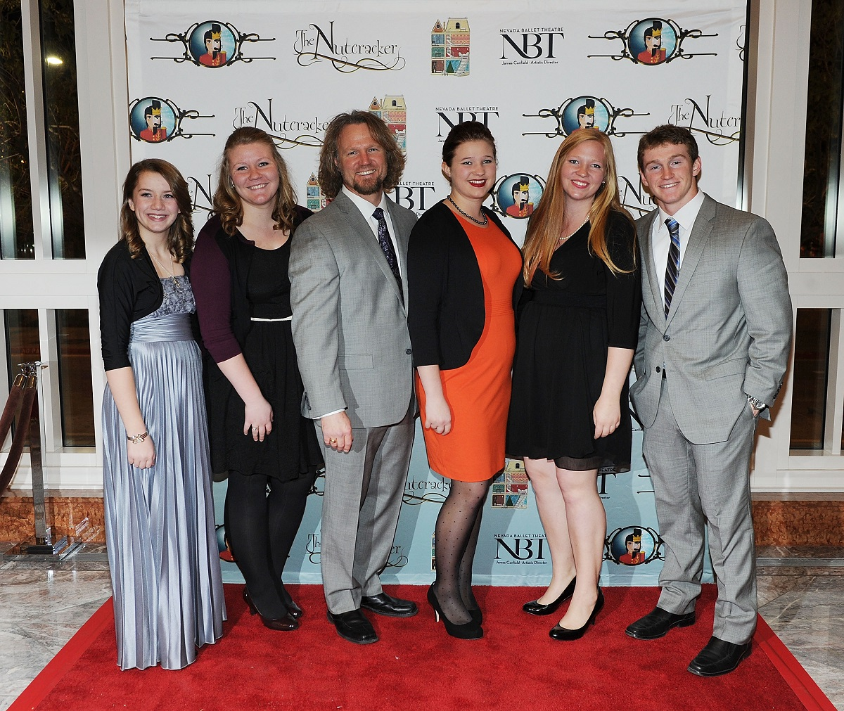 """Kody Brown and kids (Aurora, Mariah, Mykelti, Aspyn, and Logan Brown) on the red carpet at Nevada Ballet Theater's """"The Nutcracker"""" at The Smith Center For The Performing Arts in 2013 in Las Vegas, Nevada"""