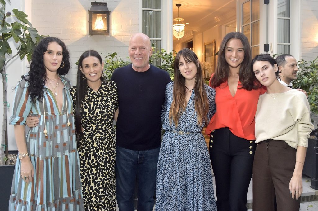 (L-R) Rumer Willis, Demi Moore, Bruce Willis, Scout Willis, Emma Heming Willis, and Tallulah Willis pose for photo at Demi Moore's 'Inside Out' book party