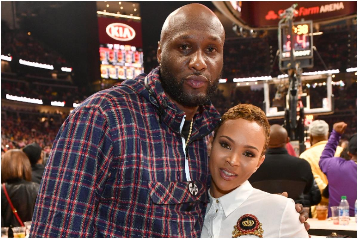 Lamar Odom and Sabrina Parr pose at the Los Angeles Lakers vs Atlanta Hawks at State Farm Arena