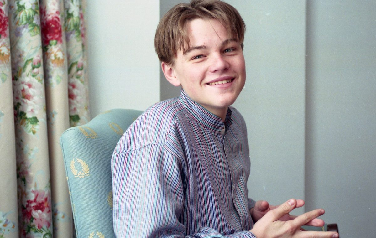 Leonardo DiCaprio sitting in a chair at age 17