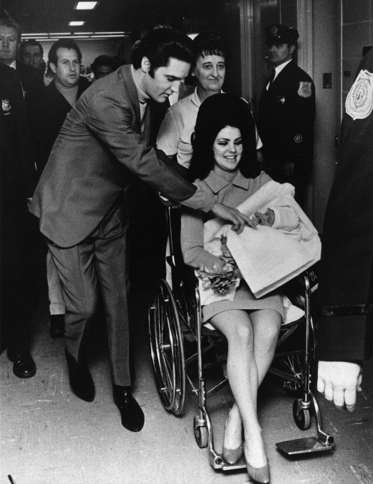 Elvis Presley and Priscilla Presley leaving the Baptist Hospital in Memphis with baby Lisa Marie Presley