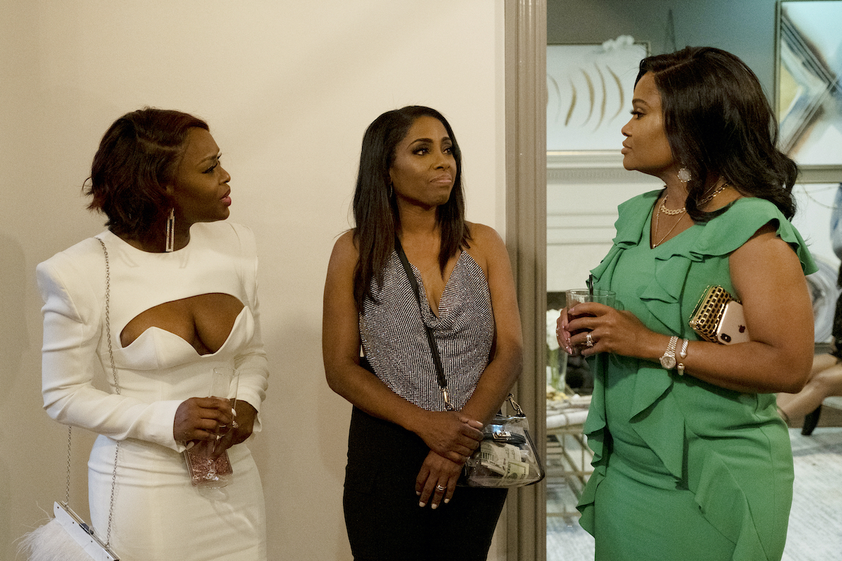 Quad Webb, Dr. Simone Whitmore, Dr. Heavenly Kimes  talk at a cocktail party