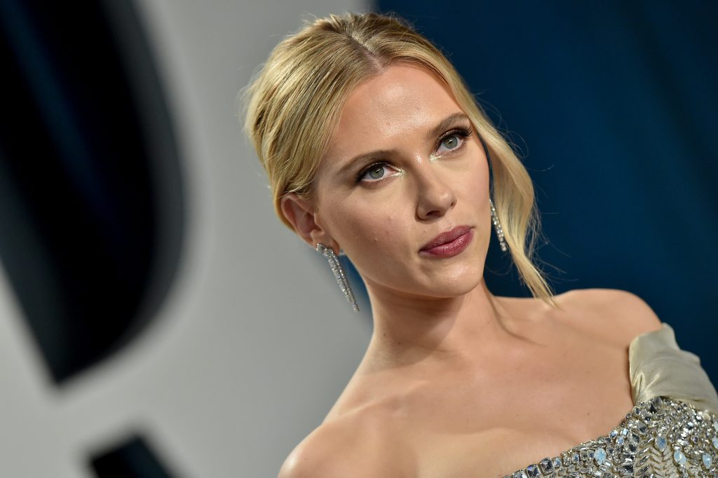 Scarlett Johansson poses for cameras with her hair up as she attends the 2020 Vanity Fair Oscar Party hosted by Radhika Jones at Wallis Annenberg Center for the Performing Arts
