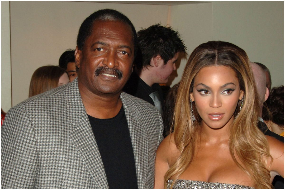 Mathew Knowles and Beyonce pose at an event.