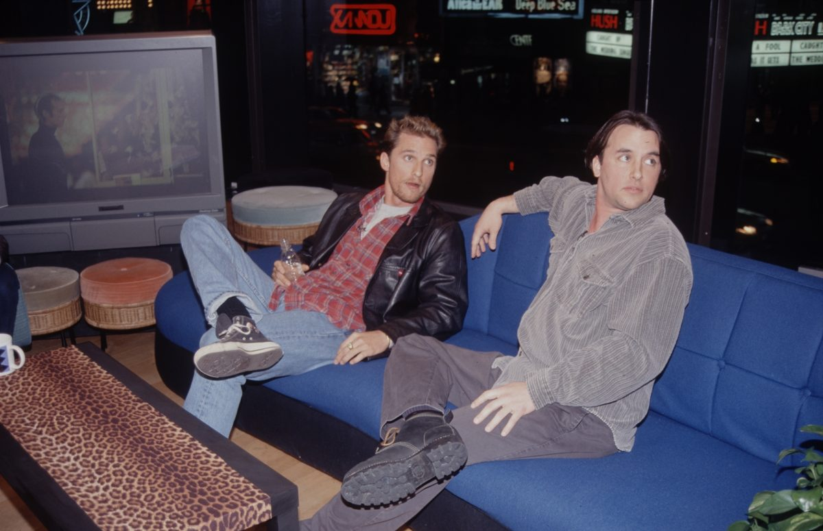 Matthew McConaughey and Richard Linklater sitting on a blue couch
